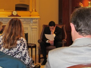 House Speaker Paul Ryan (R-WI) studying the NASBA EAS/IPAWS white paper during NAB SLC.